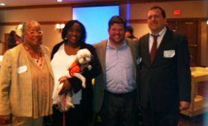 Photo: Rev. Angela Lundy, Founder/CEO of Interfaith Speciality Services; Rosalind McKelvey, Interpreter and Director & Founder of Germantown Deaf Ministries Fellowship (holding Rev. Lundy's assist dog, Iris); Neil McDevitt, Senior Instructor at Leadership Foundry & a deaf firefighter; and Chad Thomas, Communications Outreach Coordinator at the Philadelphia Department of Public  Health, pose for a picture at the Second Annual Functional Needs Symposium.