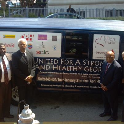 Photo: Congressman John Lewis and SCLC President CT Vivian standing near an Office of the Assistant Secretary for Health van  traveling throughout the twelve Regions of GA spreading information about the Million Hearts campaign.