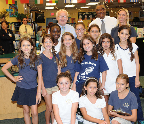 FNCS Under Secretary Kevin Concannon and FNS SERO Regional Administrator Don Arnette meet the Student Wellness Team from North Beach Elementary School, Miami Beach, Fla., during a recent visit to the school. (USDA photo by Debbie Smoot).
