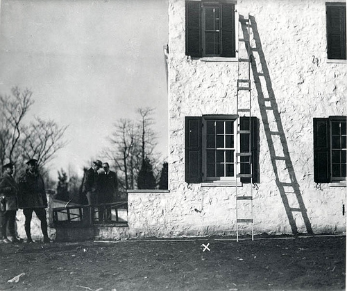 The ladder used to convict Bruno Hauptmann of kidnapping is seen here in a contemporary crime-scene photograph. Scientists at the Forest Products Laboratory were able to prove that one of the steps used in the ladder was from a plank of wood in Hauptmann's attic. Forest Service photo.
