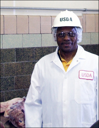 The Rev. Nonnie Holliman is suited up to do his part in keeping the nation's supply of meat and poultry products safe for consumers.