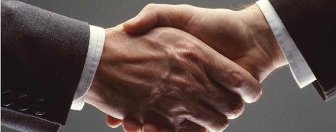 image of a hand shake, symbolizing collaboration