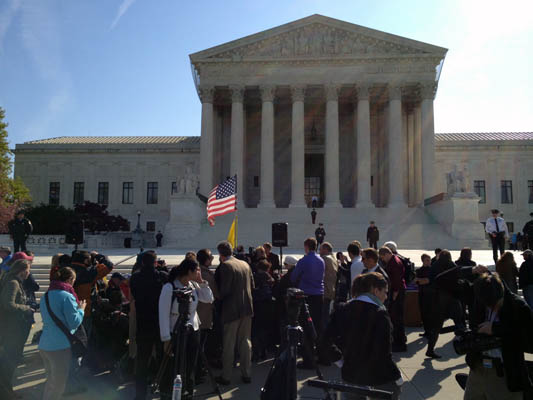 Protesters gather at the Supreme Court