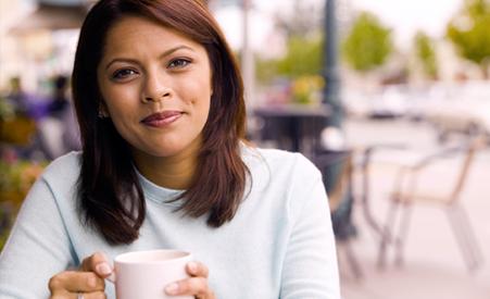 Hispanic Woman holding coffee mug