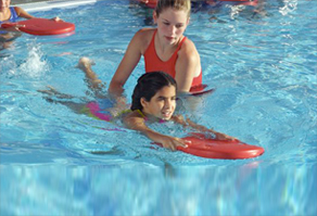 Girl Teaching Children About Water Safety