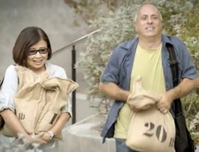Photograph of a woman and man carrying a 10 and 20 pound bag.
