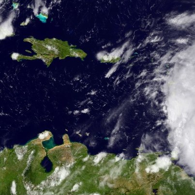 """Photo: A USAF Hurricane Hunter plane is investigating the area of low pressure located over the eastern Caribbean Sea about 100 miles west-southwest of Dominica. Preliminary data from the aircraft indicate that the low could be developing a well-defined center. Tropical-storm-force winds are occurring near portions of the Windward Islands.  If the existence of a center is confirmed, NHC will initiate advisories on Tropical Storm """"Rafael"""". Tropical Storm Warnings would then be needed for portions of the Lesser Antilles and the Virgin Islands.  Regardless of development, strong gusty winds and heavy rainfall are possible in those areas during the next couple of days as the system moves toward the northwest to north-northwest. Keep up with the latest on this system on the NOAA NHC website at www.hurricanes.gov"""