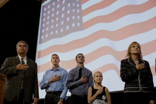 Secretary Duncan Stands during the National Anthem