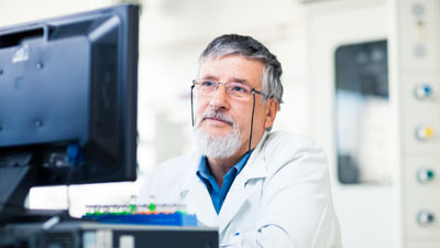 Researcher sitting at a computer.