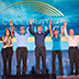 Photo of several people standing with arms raised in front of the Celebration of Science logo.