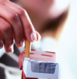 Cigarette being pulled from pack