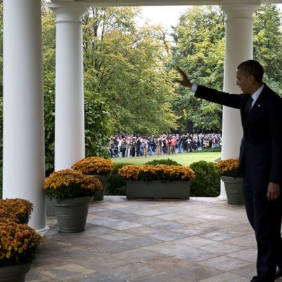 Photo: Photo of the day: President Barack Obama waves from the Colonnade to visitors as they tour the White House grounds and gardens, Oct. 19, 2012. Members of the public were invited to tour the grounds as part of the 2012 White House Fall Garden Tours. (Official White House Photo by Pete Souza)  Check out more pics from the 2012 Fall Garden Tours: http://wh.gov/kbwi