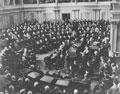 Photo of Winston Churchill speaking to legislators in crowded Senate Chamber.