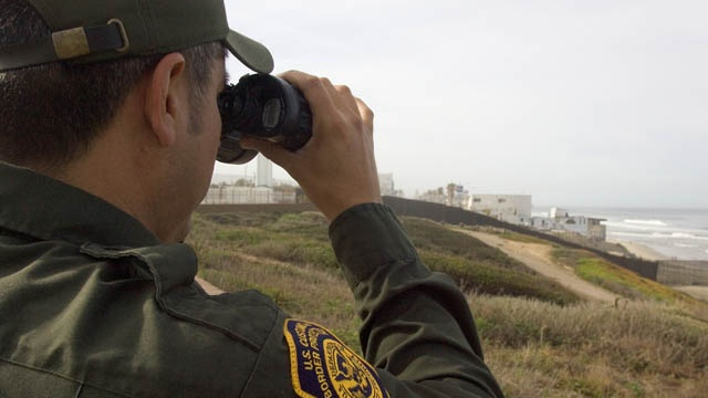 Border patrolman with binoculars