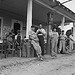 Fourth of July, near Chapel Hill, North Carolina. Rural filling stations become community centers and general loafing grounds. The men in the baseball suits are on a local team which will play a game nearby. They are called the Cedargrove Team (LOC)