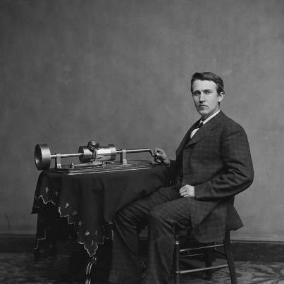 """Photo: On this day in 1877, Thomas Edison first demonstrated the operation of his new invention, the phonograph. Phonographs originally recorded sound onto tinfoil, and later used cylinders made of wax and other materials.  Many of AFC's earliest recordings of folk songs are on cylinders, beginning with the very first ethnographic field recordings, made by Jesse Walter Fewkes with Passamaquoddy singers in Maine.  Later that year in Boston, Fewkes recorded the following clip, """"Mr. Phonograph,"""" to demonstrate the use of his machine to a visiting Passamaquoddy man.    http://www.loc.gov/folklife/guide/audio/5-MrPhonograph.mp3  The photo is cropped from a digital scan of a picture in the Library of Congress's Brady-Handy collection.  It shows Edison and his second phonograph machine in 1878.  LC P&P Reproduction Number: LC-DIG-cwpbh-04044"""