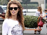 Dreaming of a white Christmas? AnnaLynne McCord dons an all-white ensemble as she picks out her tree