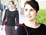 Fresh-faced and feeling festive: Emma Roberts goes make-up free to get stuck into her Christmas shopping