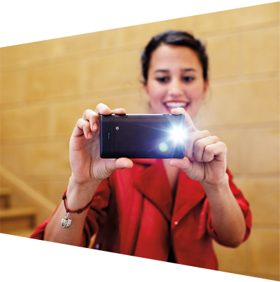 Woman taking a picture with her phone