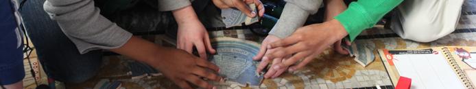 Students examine mosaic floor