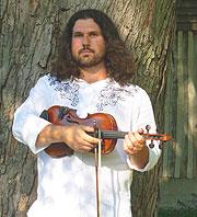 Dennis Stroughmatt with fiddle.