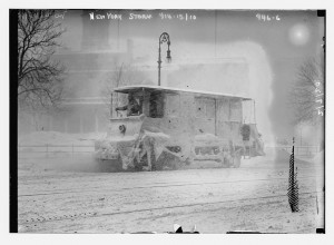 Snow plow during storm, New York