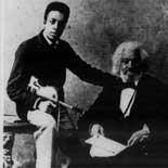 Frederick Douglass with his grandson Joseph H. Douglass, a concert violinist, ca. 1886.  Photograph.
