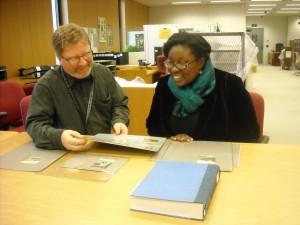 Jeff Bridgers and Kya Mangrum look at research materials