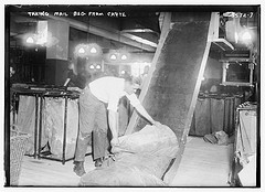 Taking mail bag from chute  (LOC)