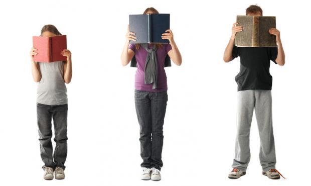 photo: three kidsholding books