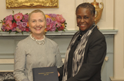 Acting Public Printer Davita Vance-Cooks presents Secretary of State Hillary Clinton a copy of Trafficking in Persons Report, which GPO produced for the State Department.