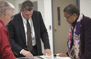 Steve LeBlanc, managing director of GPO's Security and Intelligent Documents business unit, shows products to Acting Public Printer Davita Vance-Cooks.