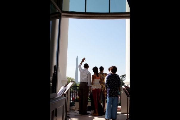President Barack Obama And First Lady Michelle Obama Wave To The Crowd