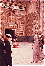 Image: Woman in a burka (actually called a chadri in Afghanistan - burka is a Pakistani term) in front of the shrine of Ali in Mazar-i Sharif, 1975. Grace Brigham.