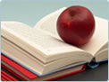 Photo of an apple on a book