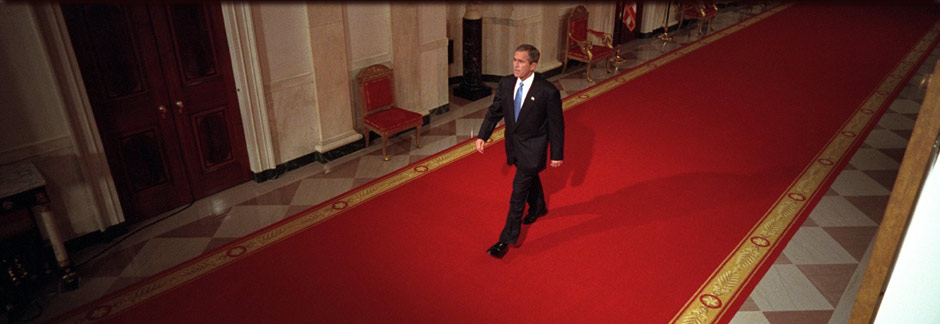 President George W. Bush walks through Cross Hall to the East Room of the White House, October 11, 2001. (P8468-08)