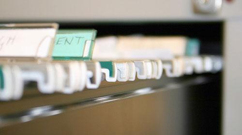 A file drawer filled with file folders