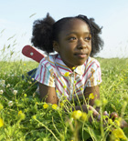 Young girl playing in field