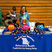 A student from Missouri stands behind the ÒHalloween Safe Zone BoothÓ at a local community center during NDFW.  Participants wore costumes and passed out candy, Shatter the Myths booklets and the Drug IQ Challenge to trick-or-treaters.