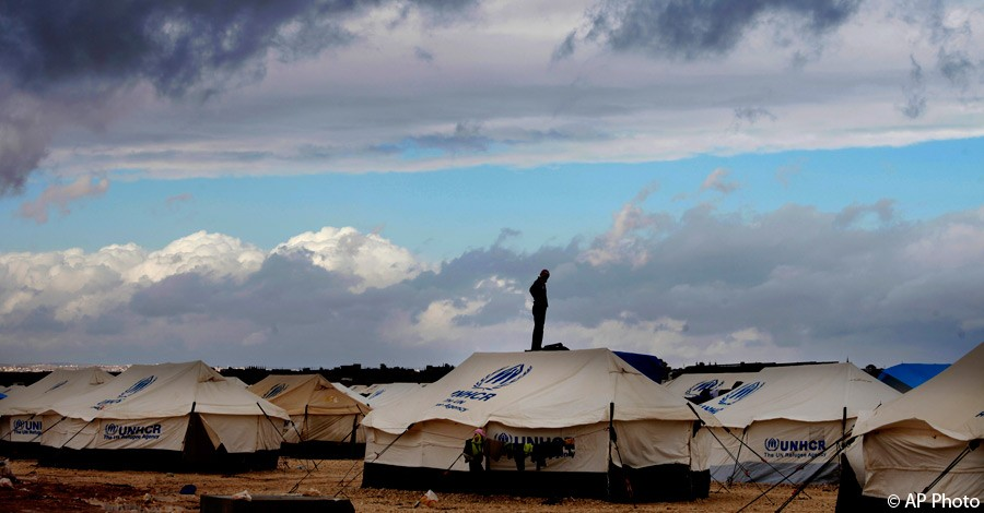 A Syrian refugee stands on top of a water tank at Zaatari refugee camp, near the Syrian border in Mafraq, Jordan, January 9, 2013. [AP File Photo]