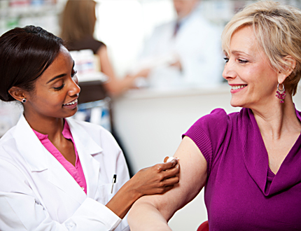 Woman getting vaccinated by female provider