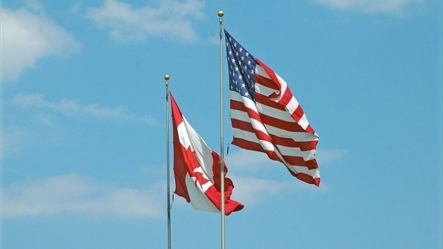 US and Canada Flags Flown Together - Photo by Joel Dinda