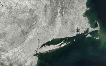 At 10:50 a.m. EST on Feb. 10, 2013, the day after the New England snowstorm, the MODIS instrument aboard NASA's Aqua satellite captured this visible image of the snow cover over the New England states, New York, New Jersey and Pennsylvania.