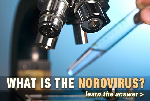 Dropping liquid into microscope.