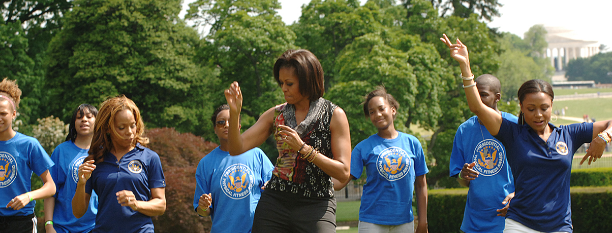 Michelle Obama, Dominique Dawes and others exercising on the White House lawn.