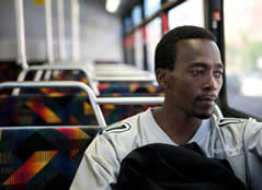 Image of a man sitting on a bus.