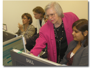 Instrucotr helping a participant while standing in front of a computer monitor
