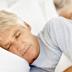 Photo of elderly an man asleep.