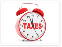 This is an image of an alarm clock with the word taxes.