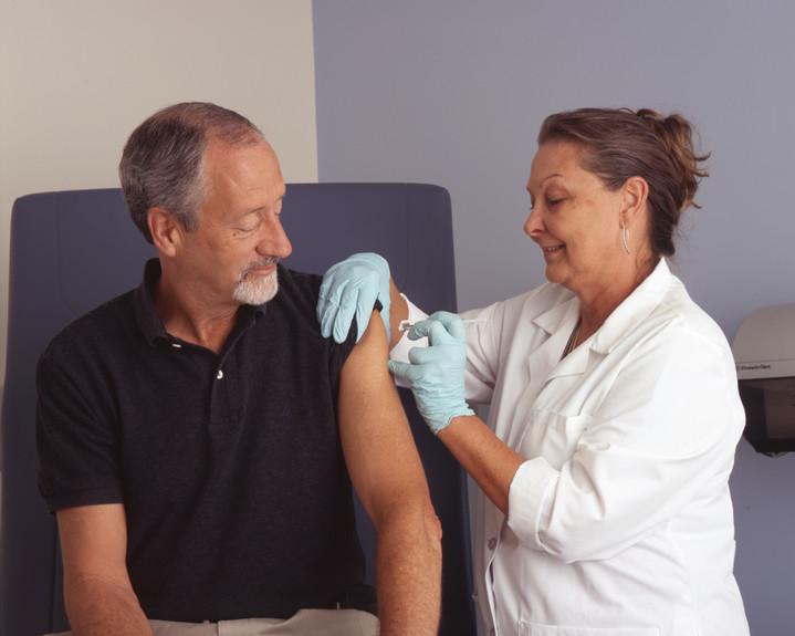Photo of an older gentleman getting a flu shot